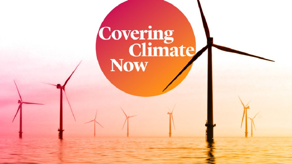 "A picture of wind turbines with a pink and orange background and a circle that looks like the sun with the text ""Covering Climate Now"""