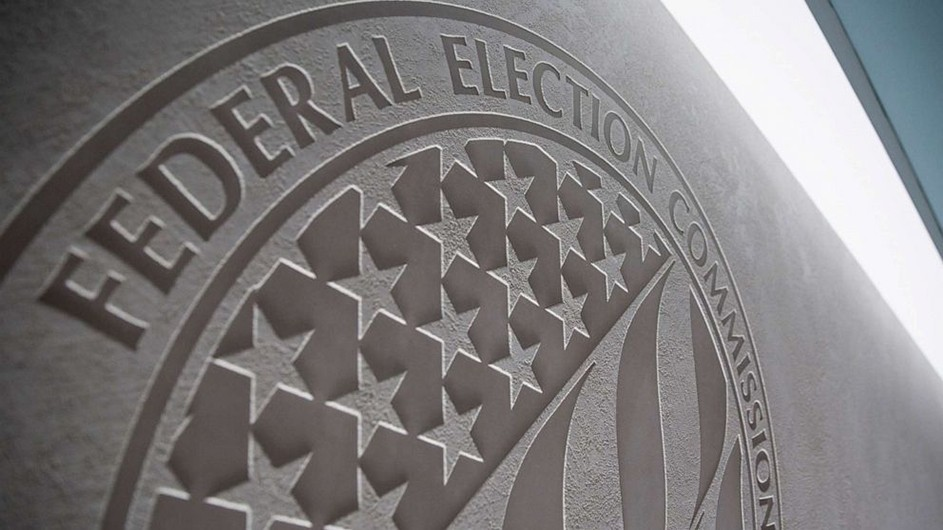 "A close-up image of a ""Federal Elections Committee"" logo on a wall"