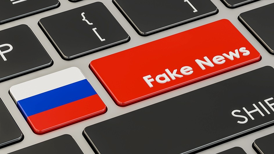 "A photo of a computer keyboard with one key that looks like the Russian flag and the other saying ""Fake News"""